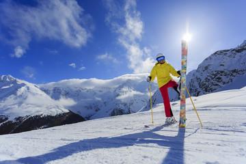 Ski, skier, sun and fun - woman enjoying ski vacation