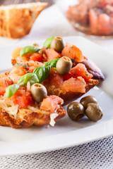 Bruschetta with mozzarella, tomato and olive