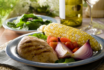 Grilled chicken breast with corn on the cob