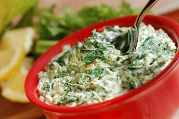 Bowl of fresh vegetarian spinach artichoke dip.