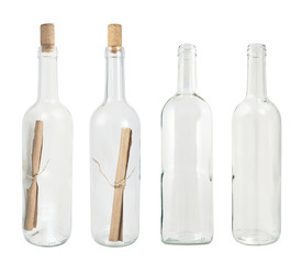 Set of four glass bottles isolated