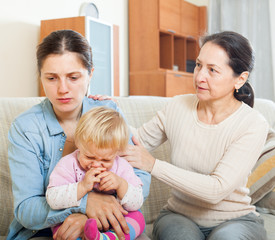 Mature woman and  mother with baby having conflict