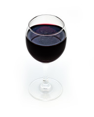 Glass of red wine on white background.