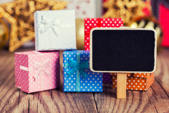 small blackboard against gift boxes