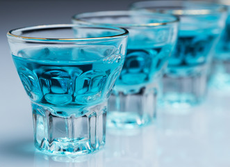 Glasses with blue drink