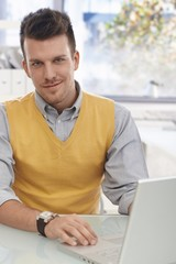 Office portrait of young businessman smiling