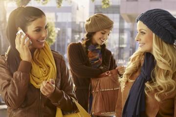 Girls walking and talking outdoors