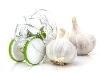Garlic Cloves with cutter on white background