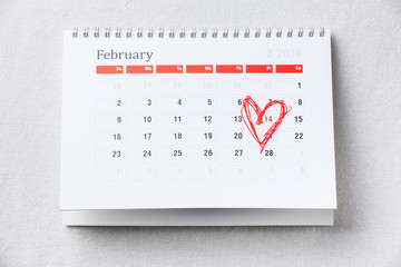 Calendar with 14 February date Valentine's day with red heart sh