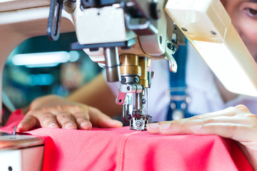 Indonesian Seamstress in Asian textile factory