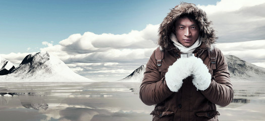 b10b063f25f Asian winter sport fashion man with backpack in snow mountain la