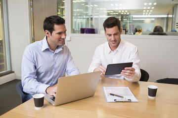 Two casual businessmen working together in modern office