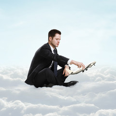 Wall Mural - man sitting on cloud