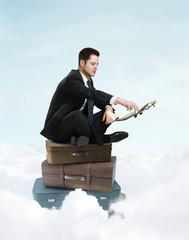Wall Mural - businessman sitting on suitcase