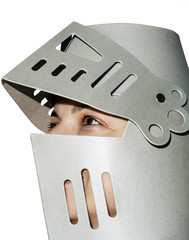 Woman with knight's helmet on the head