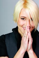Closeup portrait of a smiling blonde woman