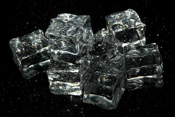 Fototapeta Ice cubes isolated on black