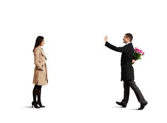 man looking at woman and greeting
