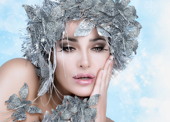 Beauty Christmas Girl with Silver Stylist. Winter Queen