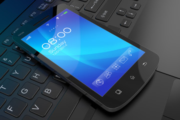 Modern smartphone on laptop.