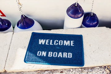 Welcome aboard mat on yacht