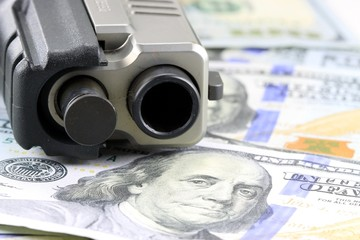 Hand Gun with American Currency Financial Security concept