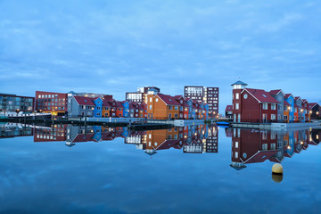 Wall Mural - colorful buildings on water at marina Reitdiephaven