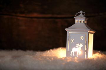 Glowing Christmas lantern shining in the night