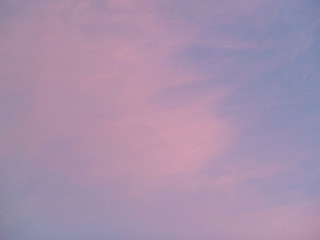 Pink and blue patterned clouds in a sky scene