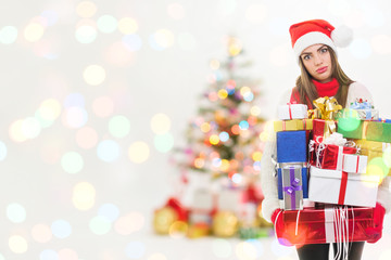 Young tired woman in Christmas euphoria with many presents
