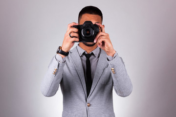 African american photographer holding a dslr camera - Black peop