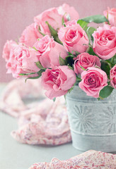 Beautiful fresh roses on a table.