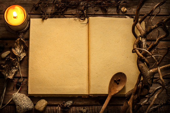 Witchcraft or magic recipes book with alchemy ingredients around