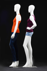 set of mannequin dressed in two colorful t-shirt and trousers