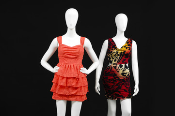 Two mannequin dressed fashionably with red dress and isolated