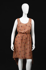 female sundress on a mannequin on a black background