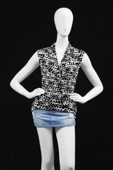 mannequin dressed in shirt on black background