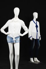 Two mannequin dressed in fashion shirt and trousers