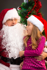 girl looking at fake Santa Claus with fake beard