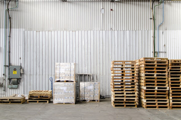 Wooden pallets stacked inside a warehouse