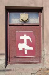 shop window with vintage shoe repair shop sign