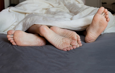 family, couple in the bed