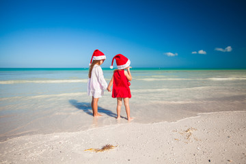 Rear view of Little cute girls in Christmas hats