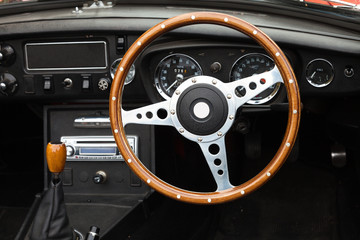 Wooden steering wheel from a MGB roadster sports car Wall mural