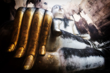 Gold Hand of Buddha at Sukhothai Province , Thailand.