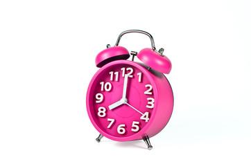 Retro pink alarm clock isolated on white