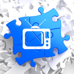 TV Set Icon on Blue Puzzle.
