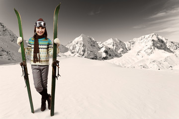 Ski, winter vacation - girl with retro ski equipment