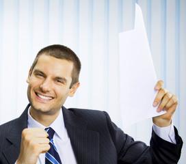 Happy successful gesturing businessman