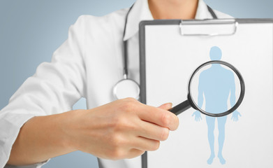 Silhouette of a man under the medical magnifying glass